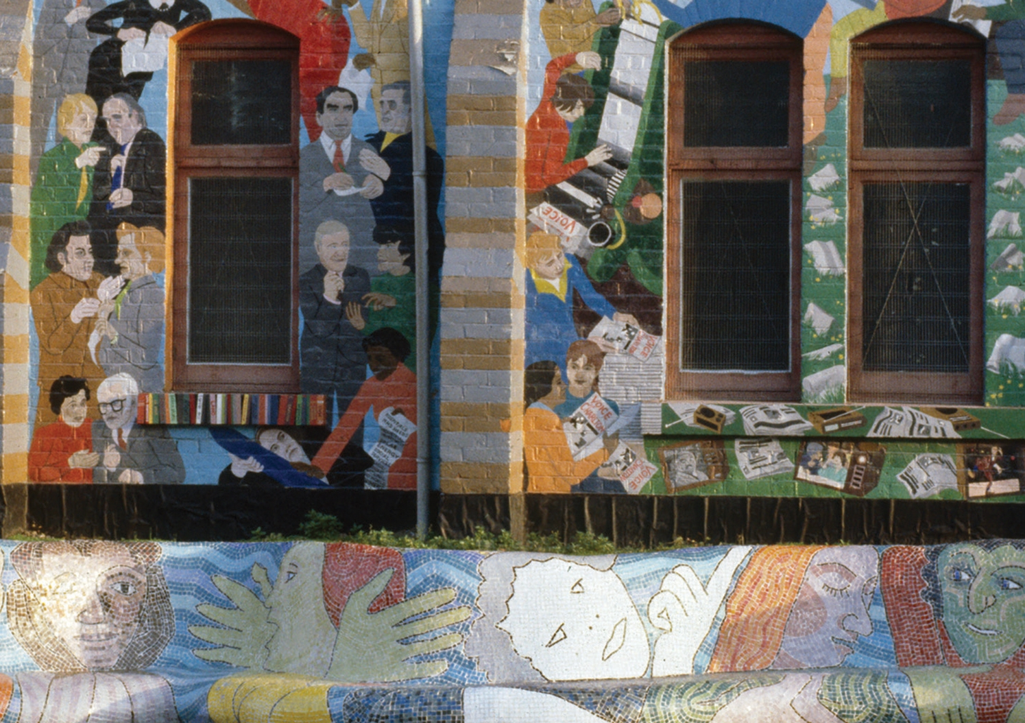 Picture of a wall and bench decorated with street murals