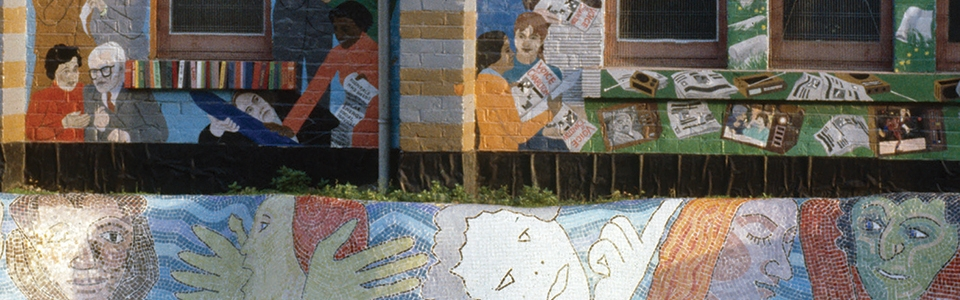 Image of a wall decorated with street murals
