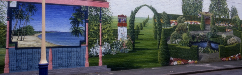 Mural of a garden and painted window looking to the seaside by Jane Gifford. Located in Mauleverer Rd, London.