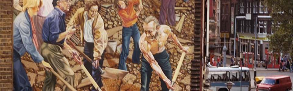 Mural of working people on the wall of a building in Earlham Street in 1977 by Pusey.