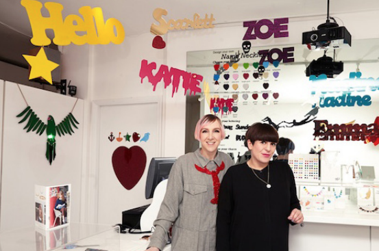 Tatty Devine Founders Photographed among their artworks